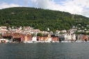 Bryggen, the old wharf quarter and the modern city behind it..